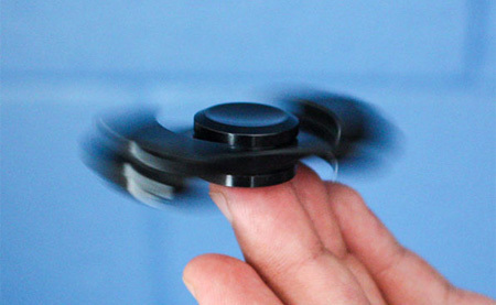 how to take the caps off a fidget spinner