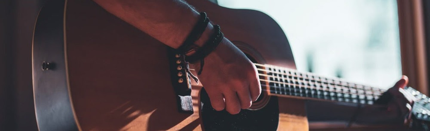 Want To Learn The Guitar? Here's How To Do It From Home