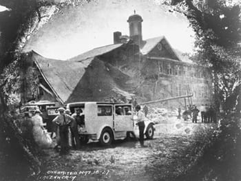 Black and white photo of a jeep in front of the Bath School in1927.