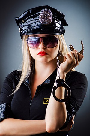 How To Get Into Tabletop Roleplaying Games In 4 Easy Steps - a woman cop brandishing handcuffs