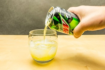 How To Get Into Tabletop Roleplaying Games In 4 Easy Steps - a hand pouring Mountain Dew into a cup