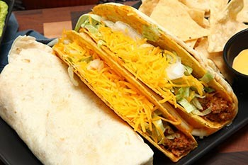 The Potato Chip That Destroyed The Bowels Of America - a bunch of soft tacos lined up in a row