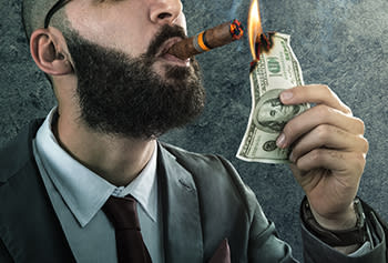6. Kick back and light a cigar with a $100 bill, or whatever it is people do when they obtain money.
