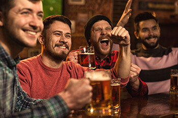 Essential Tips For Your First Stand Up Comedy Open Mic  drunk men at a bar