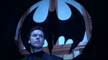 5 Actor Suggestions That Saved Characters | Michael Keaton as Bruce Wayne looking at the Bat-Signal