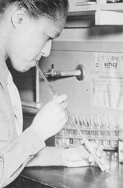 5 Medical Procedures From 30 Years Ago (That Now Seem Barbaric) - a woman using a pipette with her mouth