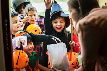 5 Unspoken Reasons The Holidays Suck For Millions Of Americans - happy children trick-or-treating