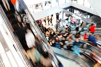 5 Unspoken Reasons The Holidays Suck For Millions Of Americans - a large crowd at a mall