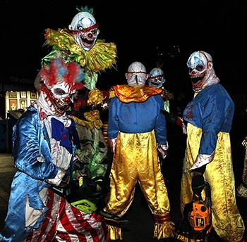 The Year The World Was 'Terrorized' By Scary Clowns (It Was 2016) - a group of scary clowns