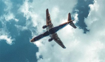 5 'Good' Ideas That Are Secretly Propaganda - shot of an airliner from beneath
