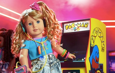 The New '80s-Themed 'American Girl' Doll Is Secretly Horrifying | American Girl doll in playing Pac-Man