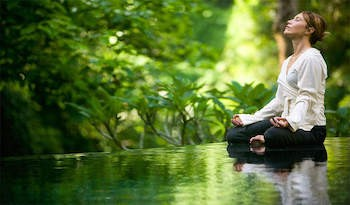 5 Crazypants Scientific Discoveries (Happening Right Now) - a woman meditating by a stream