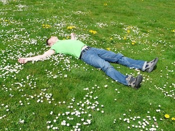 5 Crazypants Scientific Discoveries (Happening Now) - a man lying in a field of flowers
