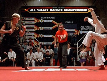 5 Lessons From 'Cobra Kai' About Reviving Old Properties | Daniel doing the crane kick to Johnny in Karate Kid