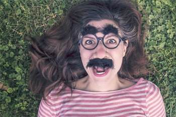Woman in glasses and mustache