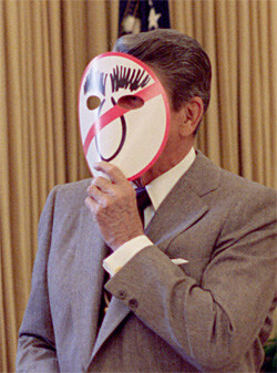 Reagan Wearing An Anti-Dukakis Mask and Showing George Shultz in Oval Office