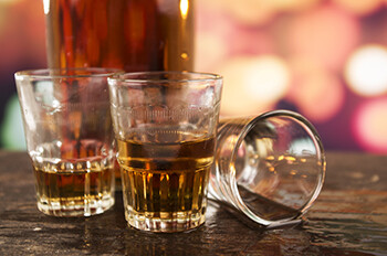 4 Occupational Hazards Stand-Up Comics Deal With bunch of empty shot glasses