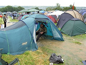 5 Festivals That Turned Into Hilarious Disasters - man with flooded tent at Glastonbury 2005