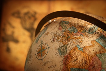 The Historical Figure Who Invented A Country (And Got Away With It) - an old globe