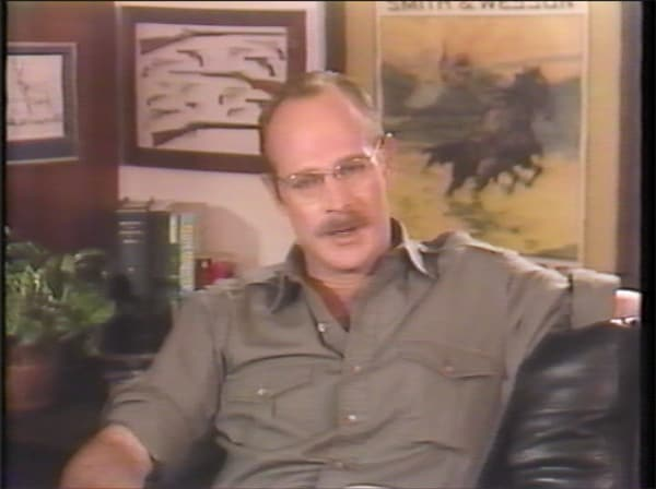 Now that Lee knows the history of ammunition storage, she's ready to move on to bandolier maintenance. Hi, I'm TV's Gerald McRaney, and I framed a picture of 13 guns.