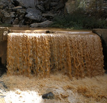 The Worst Story Ever Told, In 4 Chapters - a brown waterfall, not unlike the many pounds of human waste the Dave Matthews Band dumped on tourists