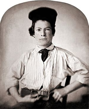 We can't tell if that's a warped photo or if the 1850s just had the bouffant <i>figured out.</i>