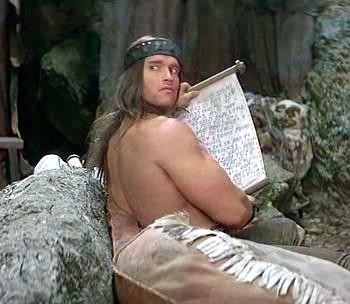 5 Classic Characters Nearly Every Adaptation Gets Wrong - Arnold Schwarzenegger as Conan the Barbarian reading a scroll
