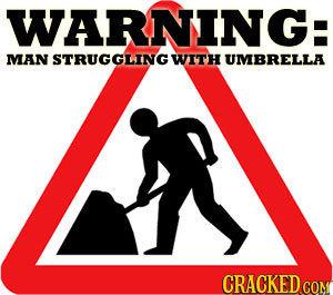 WARNING: MAN EA STRUGGLING WITH UMBRELLA CRACKED COM