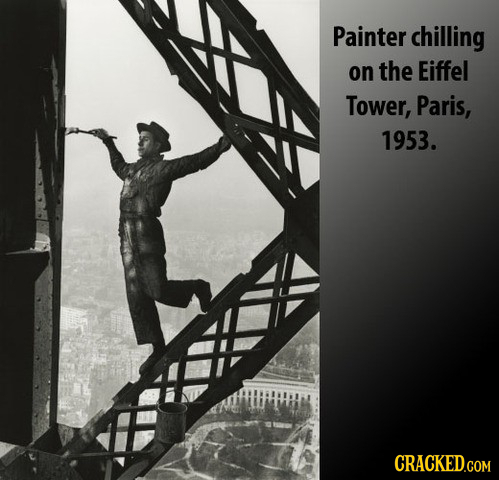 Painter chilling on the Eiffel Tower, Paris, 1953. CRACKED.COM