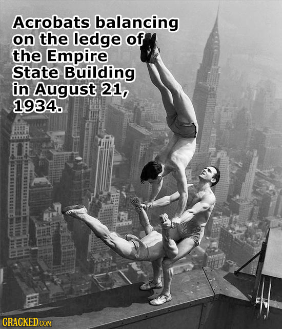 Acrobats balancing on the ledge of the Empire State Building in August 21, 1934. CRACKED COM