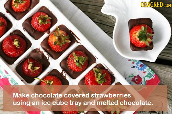 CRACKED.COM Make chocolate covered strawberries using an ice cube tray and melted chocolate.