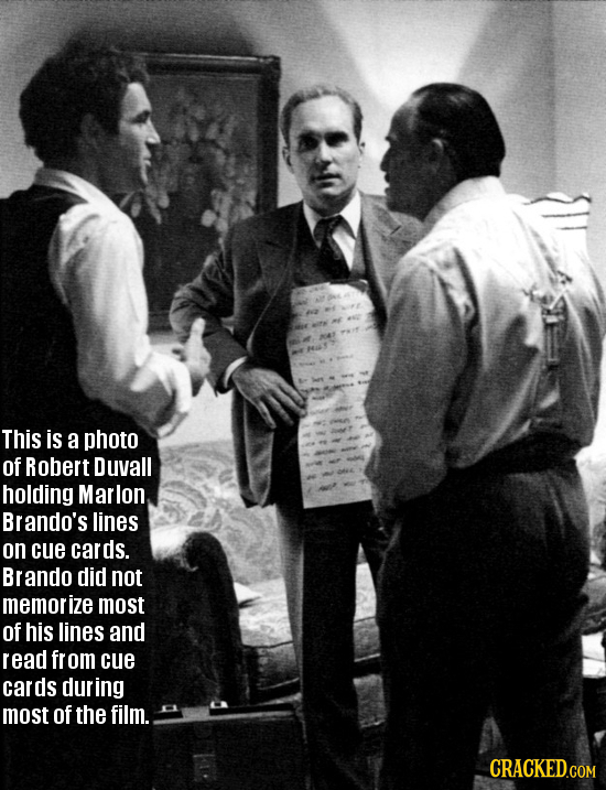 This is a photo of Robert Duvall holding Marlon Brando's lines on cue cards. Brando did NOt memorize most of his lines and read fr om cue cards during